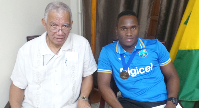 Gidron Pope and cricket administrator, Lennon John, CEO Windwards Cricket Board and manager of West Indies World champions U15 team in 2000. (Photo: E. Glenford Prescott)