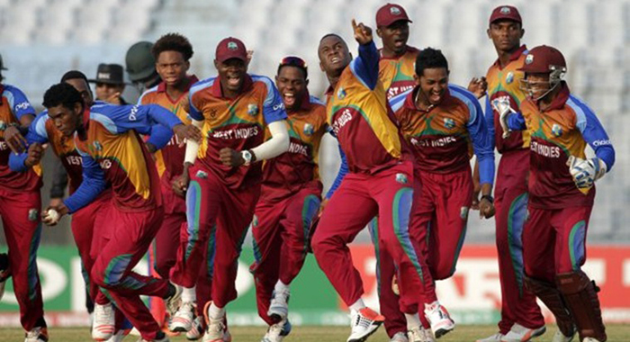 West Indies team celebrate controversial win (SVG's Gidron Pope pointing yo the sky.)