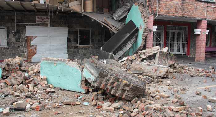 The debris from the collapse fell onto the street, but there were no reports of injury. (IWN photo)