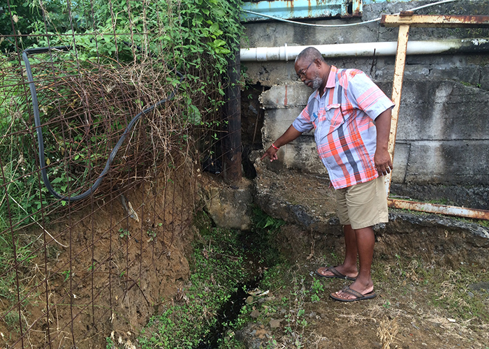 Pollard says the water is obstructing his construction of a perimeter wall around his home. (IWN photo)
