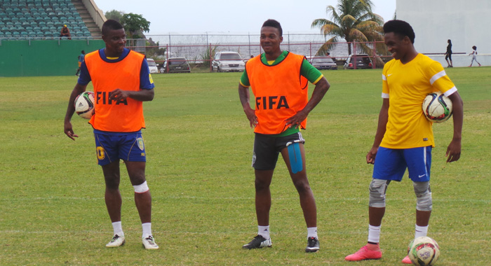 Current SVG players Shandel Samuel, Myron Samuel and Oalex Anderson about to practice spot kicks at training this week.