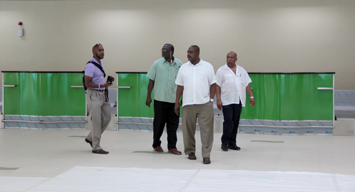 """From left, Beache, former minister of Health, Clayton Burgin, Minister of National Mobilisation, Frederick Stephenson and Minister of Tourism Cecil """"Ces"""" McKie, talk through the terminal building at Argyle International Airport on Friday. (IWN photo)"""