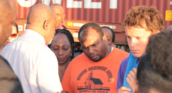 Grammar School teacher, Randy Boucher seemed in a days as he receives counselling at the Grenadines Whard on Saturday. (IWN photo)