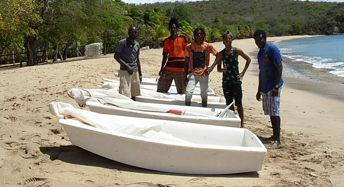 Jeremiah Forde of Grenadines Dive, sailing instructor Samuel Forde and Full Click Family members Amani Cupid, Shakeem Forde and Tevin Cupide on Mayreau's Saline Bay.