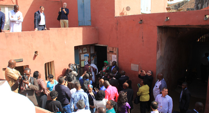 Descendants of slaves and slaves master visit the only remaining slave house on Gorée. (IWN photo)