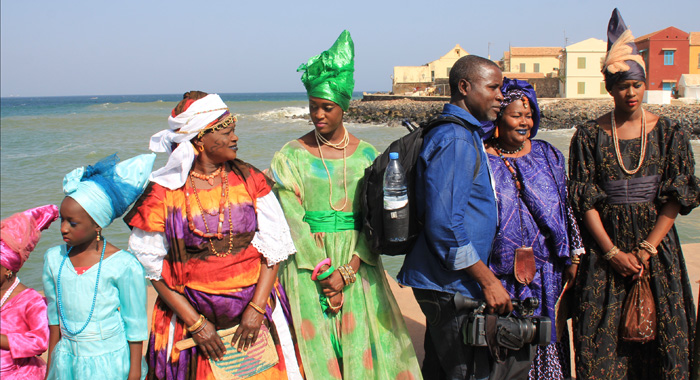 Residents of Gorée greet visitors to the island, which was once a major transhipment point for African slaves. (IWN photo)