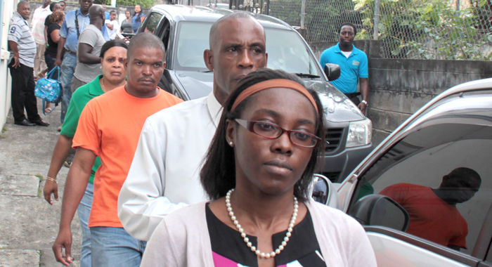 Crystal Morgan, front right, her father, Pastor Nigel Morgan and police officers arrive at the Serious Offences Court in Kingstown on Friday. (IWN photo)