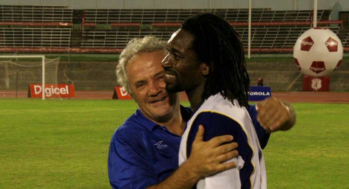 Vranes, left, seen here congratulating goalscorer Wesley John after SVG's historic 2-1 win over Jamaica, could also be in the running for consideration as head coach.