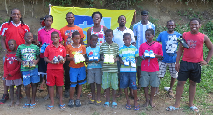 Some Of The Recipients Of Football Shoes Along With Parents And Members Of The Kenville Horne Sports Academy 1