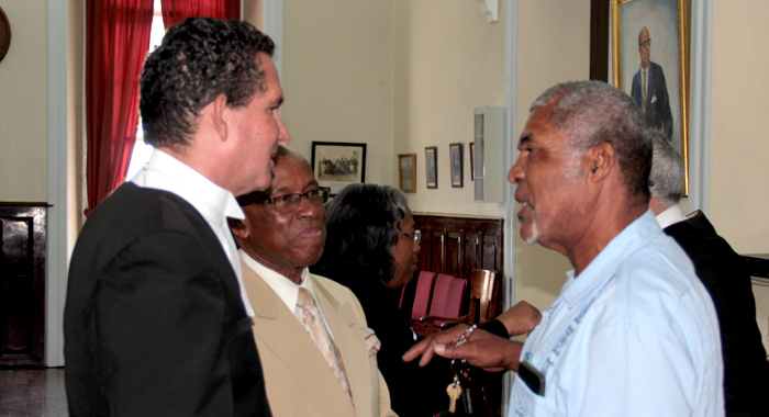 MP for North Windward, Montgomery Daniel, right, Mp for Central Leeward, Sir Louis Straker, and member of their legal team, Grahame Bollers chat after Thursday's court appearance. (IWN photo)