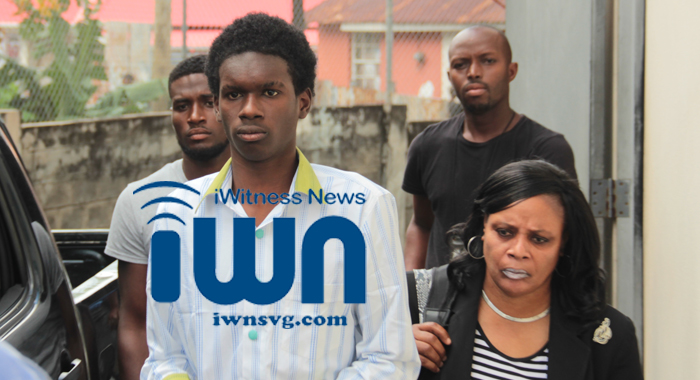 Murder accused Maverick Joseph is escorted from court by detective Station Sergeant Sherol James and other police officers. (IWN photo)