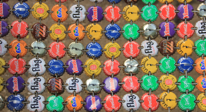 Extreme recycling. Continue to read to find out what second life is given to these crown covers. (IWN photo)