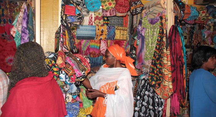 And artisan and customers insider her shop on Gorée Island. (IWN photo)
