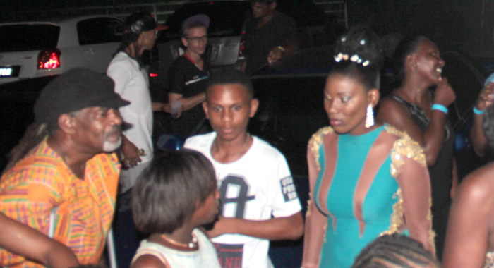 A disgruntled Second Runner-up Keishell Robertson, right, speaks with persons backstage after the show. (IWN photo)