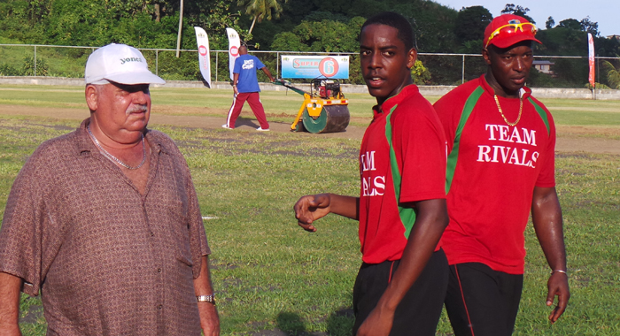 Veira with Anson Latchman and Deightom Butler after their T20 triumph.