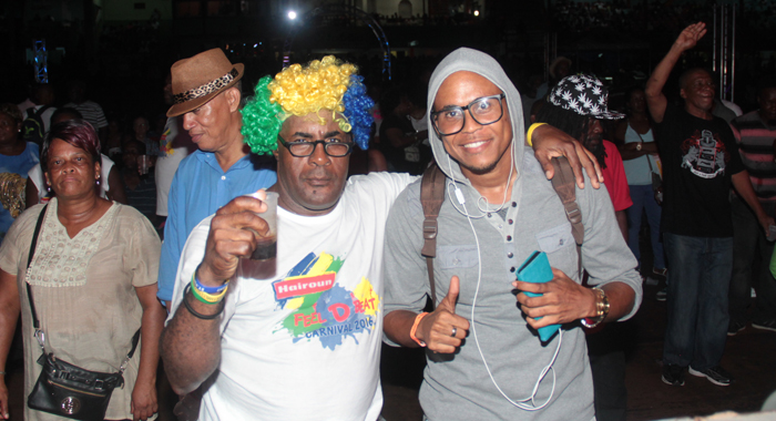 """Reigning Monarch, Zamfir """"ManZangie"""" Adams, right, pose with calypso fan Augustus """"Sappy"""" Evans at the semis. (IWN photo)"""