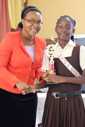 With the 2016 Most Improved Student Precious Williams of the Sion Hill Government School. I presented the award to her on behalf of the Friends of Sion Hill organization in New York.