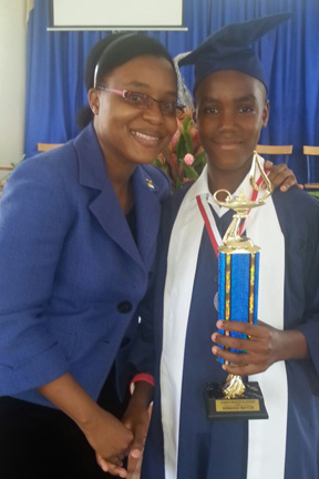 With the 2016 Valedictorian and Student of the Year Roshad Boyce of the Rose Hall Government School. I donated and presented the Anesia Baptiste award for Student of the year to this young man.