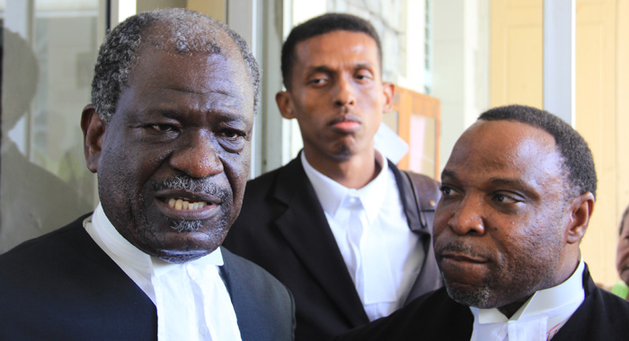 """NDP lawyer, Stanley """"Stalky"""" John, QC, right, a Keith Scotland, speak with reporters outside the court on Thursday. (IWN photo)"""