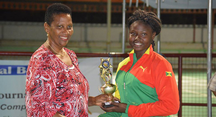 Player of the tournament, Jamiella John of Grenada receiving trophy from President of the Grenada Netball Association,Glennis Roberts.