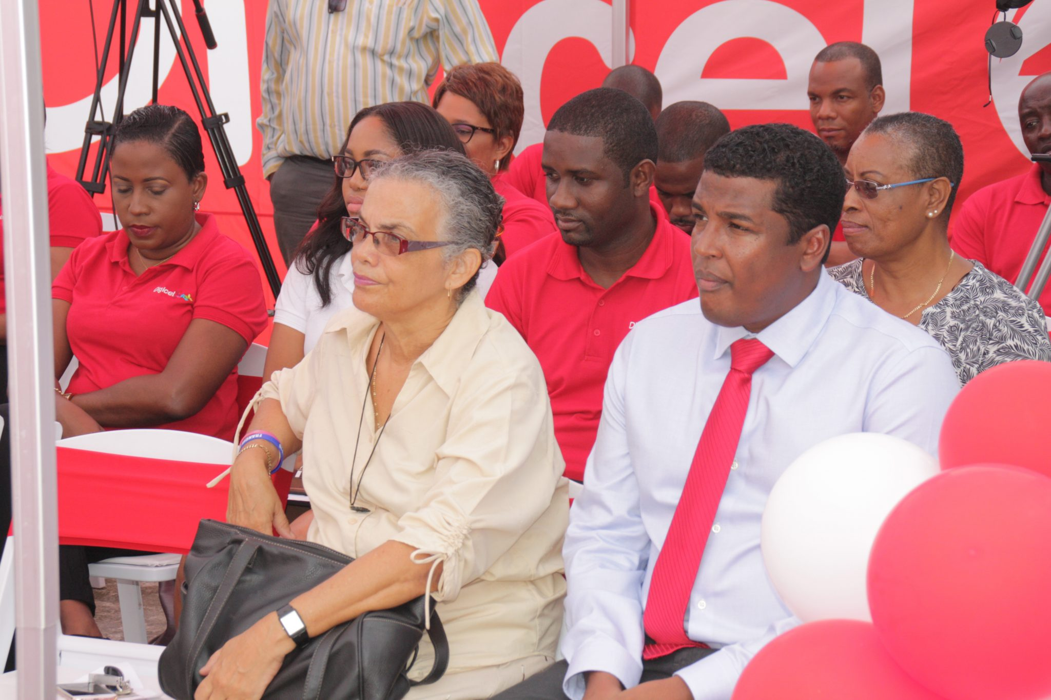 Miriam Sheridan, left, Gidharry and other Digicel staff at Tuesday's unveiling. (INW photo)