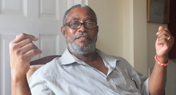 Stephen Pollard sits on the ground floor of his house, where he wants to start a tourism business. (IWN photo)