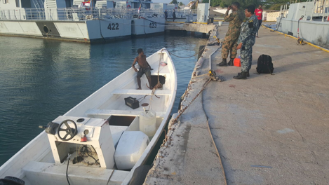 "Fishing eessel ""Sharky"" alongside JDF Coast Guard Base, onboard is Macgyver Allick of SVG."