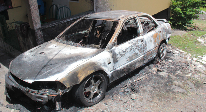 The burnt out car outside the house on Monday. (IWN photo)