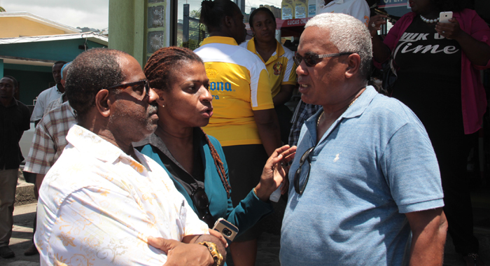 Maferne Mayers-Oliver, centre, who and her husbnad, Lance Oliver, own Chill Spot speaks with the Town Planner Shelford Stowe, during the demolition. (IWN photo)