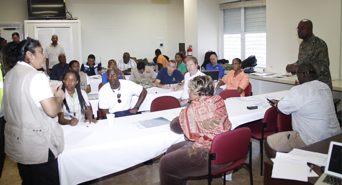 CDEMA assessors participate in a briefing at the National Emergency Management Agency (NEMA) on Saturday. (CMC photo)