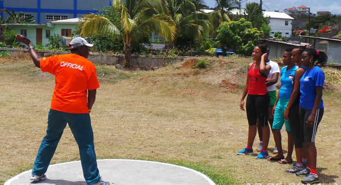 Veteran field athlete Genita Lewis explains discuss-throwing technique to female athletes at a session two years ago at Arnos Vale.