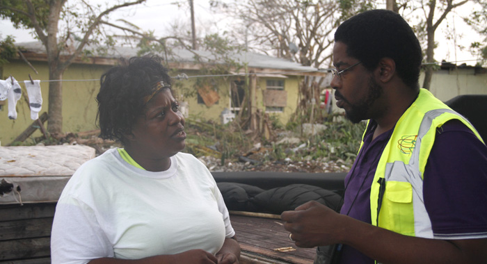 Beulah Laing, left, speaks with Dr. Avery Hinds of CARPHA, who was one of the rapid response assessors that CDEMA deployed to the Bahamas after the hurricane. (Photo: CMC/IWN)