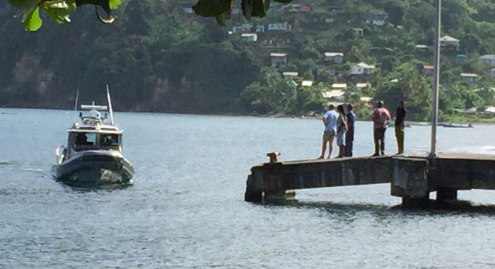 Police, Coast Guard officers and the captain at the Chateaubelair harbour.
