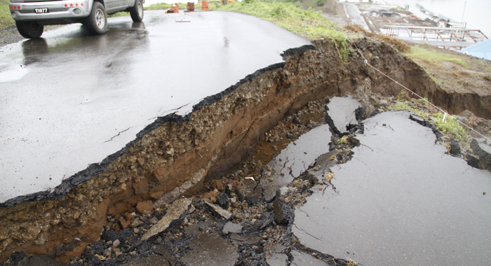 This large crack has completely severed the road. (IWN Photo)