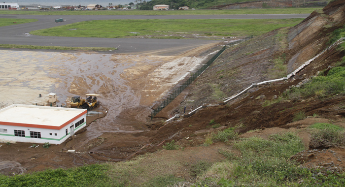 The earth movement deposited a large amount of mud and water onto the apron of the incomplete airport. (IWN photo)