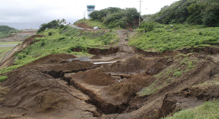 Large cracks opened up in the earth between the road and the airport on Thursday. (IWN photo)