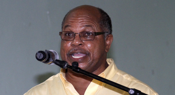 NDP chairman Linton Lewis addresses the party's extraordinary convention in Kingstown on Sunday. (IWN photo)