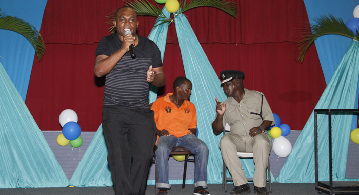 "Retired police chief, Michael Charles, left, supported the show by making a guest performance, as well as appearing during artistes' performance, as he did here, during one of Renrick ""Mighty Bamboo Joint"" Cato's rendition. (IWN photo)"