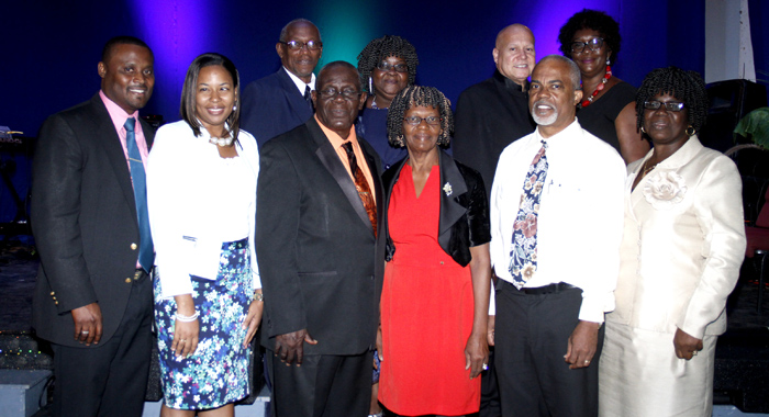 Nazarene clergy members in St. Vincent and their wives pose for a photo after the service.
