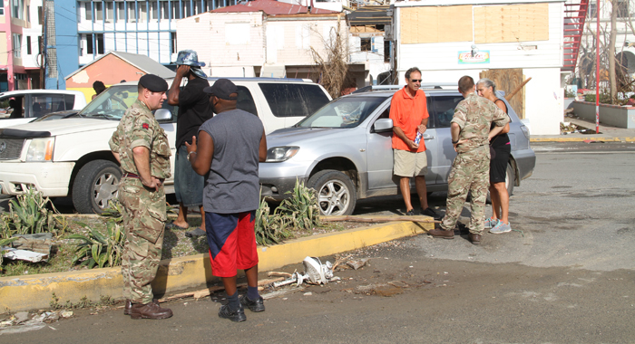 British Troops Speak To Persons In Road Town On Monday. Cmc Photo