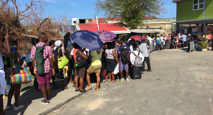 Persons Queue Outside The Deep Water Harbour On Roseau On Thursday Hoping For An Opportunity To Leave Storm Ravaged Dominica. Cmc Photo