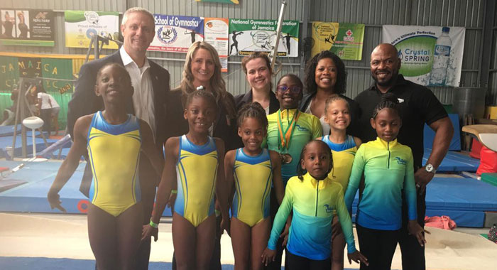 Svg Team With Judges At Competition
